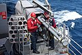 USS Harry S. Truman (CVN 75) sailors load a missile into a Rolling Airframe Missile launcher.jpg