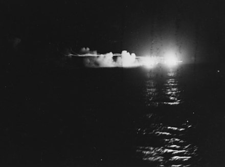 HMNZS Leander fires on the Japanese cruiser Jintsu. USS St. Louis (CL-49) and HMNZS Leander firing during the Battle of Kolombangara, 13 July 1943 (80-G-342763).jpg