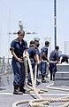 US Navy 020720-N-3580W-073 Line handlers aboard USS Hopper.jpg