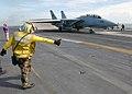 US Navy 021211-N-6895M-503 plane director positions an F-14.jpg