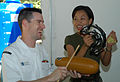 US Navy 030613-N-0493B-007 Royal Thai Marine musician jumps in with the tambourine.jpg