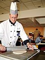 US Navy 030717-N-5821W-002 Daniel Lundberg, an instructor from the First Coast Technical Institute School of Culinary Arts in Saint Augustine, Fla., uses a rolling pin to flatten dough.jpg