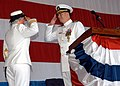 US Navy 030815-N-5027S-001 Capt. Norma Lee Hackney and Capt. Christopher Hase exchange a salute signifying the change of command aboard the Amphibious Warfare Ship USS Saipan (LHA 2).jpg