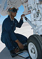 US Navy 040622-N-4211M-115 Navy Airman Lincoln S. Daley from Brooklyn, NY, assigned to the Bounty Hunters of Strike Fighter Squadron Two (VFA-2), performs pre-flight maintenance checks.jpg