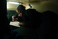 US Navy 040622-N-6278K-041 Operations Specialist Seaman Shantrell King, from Dallas, Texas, reads a book in her rack, after her working hours aboard USS George Washington (CVN 73).jpg