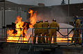 US Navy 050210-N-7615S-005 - Military Sealift Command Merchant Marine Sailors combat a simulated flight deck fire at the firefighting course on board Fleet Training Center, San Diego.jpg
