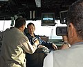 US Navy 050326-N-9693B-008 A news team from Al Iraqiya TV, one of only two national television stations in Iraq, interviews Commanding Officer of USS Bonhomme Richard (LHD 6), Captain J. Scott Jones.jpg