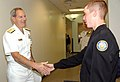 US Navy 050426-N-4729H-022 Commander, Navy Recruiting Command, Rear Adm. Jeffrey Fowler, greets a student at the Delaware Military Academy.jpg