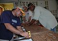 US Navy 050827-N-5914D-010 Sailors assigned to the amphibious assault ship USS Boxer (LHD 4), install a kitchen counter in Assumption Catholic School during a community outreach project in Majuro, Marshall Islands.jpg