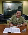 US Navy 051007-N-2383B-022 Chief of Naval Operations (CNO) Adm. Mike Mullen, signs his Combined Federal Campaign (CFC) pledge card in his office at the Pentagon.jpg