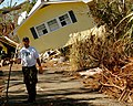 US Navy 051026-N-3729H-102 U.S. Navy Machinist Mate Fireman Andrew Westermire, assigned to the Nimitz-class aircraft carrier USS John C. Stennis (CVN 74), help locals clear their driveway of debris left by Hurricane Katrina.jpg