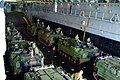 US Navy 060329-N-4772B-133 - Marines from the 31st Marine Expeditionary Unit (MEU) stage in their Amphibious Assault Vehicles (AAV) as they prepare to depart the well deck of the amphibious dock landing ship USS Harpers Ferry (.jpg
