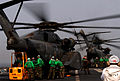 US Navy 060508-N-7711S-192 Flight deck personnel unload an MH-53E Sea Dragon assigned to Helicopter Mine Support Squadron One Five (HM-15) on the flight deck aboard the Nimitz-class aircraft carrier USS Ronald Reagan (CVN 76).jpg