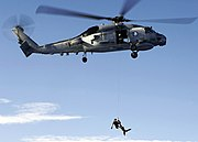 US Navy 060730-N-IJ727-011 An SH-60B Seahawk helicopter assigned to HSL-47 lowers a rescue swimmer