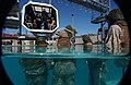 US Navy 061129-N-5169H-366 U.S. Marines from Golf Company, 2nd Battalion, 1st Marine Regiment observe a modular amphibious egress trainer being lowered into the pool as they wait to conduct egress training.jpg