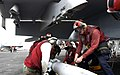 US Navy 070302-N-7130B-037 Sailors assigned to the Nimitz-class aircraft carrier USS Ronald Reagan (CVN 76) direct the loading of a Guided Bomb Unit-38 (GBU-38) onto an F-A-18F Super Hornet.jpg