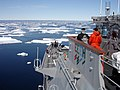 US Navy 070612-N-2889B-001 Ship's Serviceman Seaman Recruit Jamal Powell, left, and Seaman Recruit Stephen Harmon stand forward lookout watch aboard guided-missile cruiser USS Normandy (CG 60) as the ship navigates an ice field.jpg