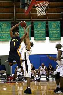 US Navy 071103-M-9013C-001 Seaman Devon Wilson, All-Navy forward, shoots a lay up against the Army defense during game two of the Armed Forces Men's Basketball Championships.jpg