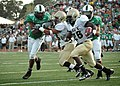 US Navy 071110-N-8053S-140 During the Navy vs. University of North Texas (UNT) football game, Navy Midshipmen running back, Shun White, attempts a to run against UNT's defense.jpg