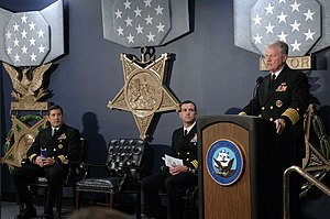 Vice Admiral James Bond Stockdale Award for Inspirational Leadership - Image: US Navy 071128 N 8273J 008 Chief of Naval Operations (CNO) Adm. Gary Roughead speaks in honor of the Vice Adm. James Bond Stockdale awardees, Cmdrs. Frank J. Olmo and Craig A. Clapperton