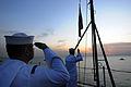 US Navy 081029-N-3659B-024 Sailors lower the Navy Jack.jpg