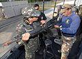 US Navy 090508-N-6403R-137 JOHN C. STENNIS SPACE CENTER, Miss. (May 8, 2009) Naval Small Craft Instruction and Technical Training School instructor Doug Maldonado assist Brazilian Federal Police agent.jpg