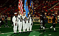 US Navy 090613-N-3750S-492 Members of the Navy Color Guard join the Oklahoma City Yard Dawgz players on the field at Cox Convention Center during the opening ceremony.jpg
