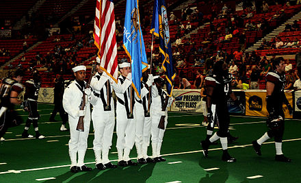 Members of the Navy Color Guard join the Oklahoma City Yard Dawgz players on the field at Cox Convention Center during the opening ceremony US Navy 090613-N-3750S-492 Members of the Navy Color Guard join the Oklahoma City Yard Dawgz players on the field at Cox Convention Center during the opening ceremony.jpg