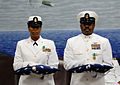 US Navy 090724-N-4698K-016 Personnel Specialist Chief Greta Thomas stands next to her husband, Aviation Electrician's Mate Senior Chief Norris Thomas, following the passing of the flag honoring their combined 49 years of servic.jpg