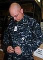US Navy 091130-N-3666S-012 Gunner's Mate 1st Class Matthew Lozowy tries on the Navy Working Uniform.jpg