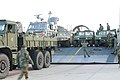 US Navy 100114-N-5787K-003 Seabees assigned to Amphibious Construction Battalion (ACB) 2 load vehicles and equipment onto landing craft air cushion vehicles to support Operation Unified Response.jpg