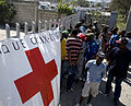 US Navy 100125-N-6266K-135 Haitian earthquake survivors wait to receive non-perishable goods from a local Red Cross distribution site in Port-au-Prince.jpg
