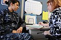 US Navy 100210-N-1238B-045 Engineman Fireman Apprentice Sherrelle Herrera, assigned to the Transient Personnel Unit, Naval Station Norfolk, talks with Cristy Stamenkouich, an education advisor for Navy College at Naval Station.jpg