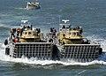 US Navy 100313-N-9301W-079 Landing craft mechanized and a landing craft utility (LCU) transport vehicles to the amphibious dock landing ship USS Fort McHenry (LSD 43).jpg