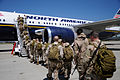 US Navy 100405-N-0475R-115 Seabees assigned to Naval Mobile Construction Battalion (NMCB) 5 board a plane at Naval Air Station Point Mugu to begin an eight-month deployment to Afghanistan.jpg