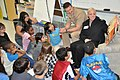 US Navy 100416-N-3750S-264 Cmdr. Mark Hofmann, left, commanding officer of Navy Operational Support Center, San Antonio, and Yeoman 1st Class Dana Gilbert, read a story to children at Carl Wanke Elementary School during San Ant.jpg