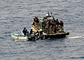 US Navy 100506-N-1082Z-017 The visit, board, search and seizure team assigned to USS Ashland (LSD 48) board and inspect two fishing skiffs for suspected pirate activity.jpg