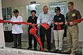 US Navy 100604-N-6410J-220 Pacific Partnership representatives cut a ribbon with a Ministry of Health of Vietnam official and a Quang Trung Hospital physician during a rededication ceremony.jpg