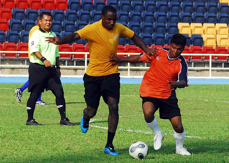 US Navy 100611-N-0995C-160 Ship's Serviceman Seaman Chika Ndubizu assigned to the guided-missle frigate USS Vandegrift (FFG 48) works to keep possession of the ball.jpg