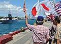 US Navy 100621-N-8539M-595 Onlookers wave as the Japan Maritime Self-Defense Force Oyashio-class submarine J.S. Mochishio (SS 600) arrives at Joint Base Pearl Harbor-Hickam to support Rim of the Pacific (RIMPAC) exercises.jpg