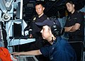 US Navy 100711-N-0995C-050 Republic of Singapore navy officers observe Operations Specialist 2nd Class Jessica Proudfoot track contacts during an anti-submarine warfare exercise aboard the guided-missile destroyer USS Chung-Hoo.jpg