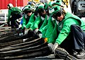 US Navy 100821-N-7908T-108 Sailors assigned to the air department of aircraft carrier USS George H.W. Bush (CVN 77) rig a barricade during flight deck drills.jpg