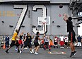 US Navy 100925-N-2013O-225 A Sailor shoots a basket while playing a 3-on-3 basketball game during a steel beach picnic aboard the aircraft carrier.jpg