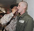 US Navy 101029-N-8848T-409 Gunnery Sgt. Robert Stahl encourages officer candidate Jared Good, from Towanda, Pa., during the first week of the 12-we.jpg
