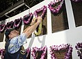 US Navy 101111-N-3560G-003 Retired Lt. Cmdr. Paul Jurcsak from the Bowfin Base, Honolulu, U.S. Submarine Veterans organization, presents a lei in.jpg