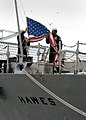 US Navy 101210-N-5292M-128 Sailors assigned to the guided-missile frigate USS Hawes (FFG 53) lower the Ensign for the last time during the ship's d.jpg