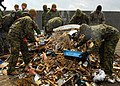 US Navy 110404-N-8607R-036 Marines assigned to the 31st Marine Expeditionary Unit (31st MEU) pick up debris on Oshima, as part of ongoing disaster.jpg