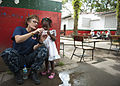 US Navy 110606-N-NY820-268 Lt. Cmdr. Linda Wisman shows photos on her camera to a child at Escuela Max Seidel during a Continuing Promise 2011 comm.jpg