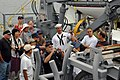 US Navy 110727-N-OB313-102 Machinist Mate 3rd Class Marc Miller, assigned to the mine countermeasures ship USS Champion (MCM 4), gives a tour of th.jpg