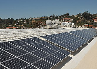 Solar power in the United States - A view of solar panels installed in 2011 on the roof of Space and Naval Warfare Systems Command Headquarters, San Diego. The rooftop photovoltaic installation supports the Department of Defense's goal of increasing renewable energy sources to 25 percent of all energy consumed by the year 2025.